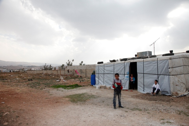 Syrian children outside their temporary home, in Lebanon's Bekaa Valley