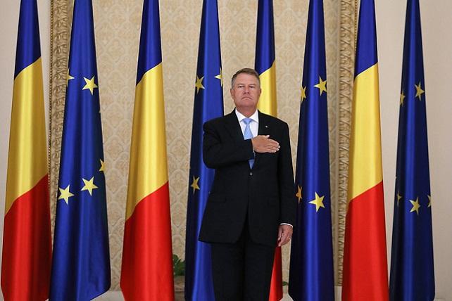 Romanian President Klaus Iohannis, flag of Romania and European