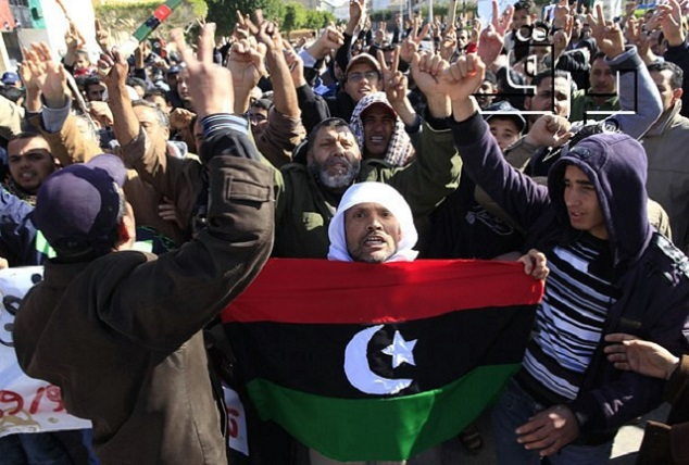 Protesters opposed to leader Muammar Gaddafi chant slogans in the city of Zawiyah