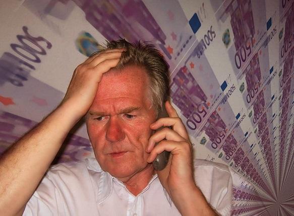 man-face-phone-despair