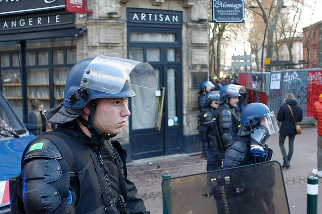 man-wearing-blue-riot-helmet